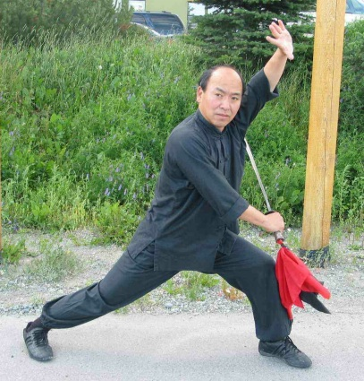 Photo of Master Wong wielding a saber